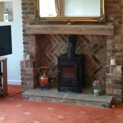 Feature-fireplace-with-log-burner-by-Packington-Building-Services-in-Burton-on-Trent.
