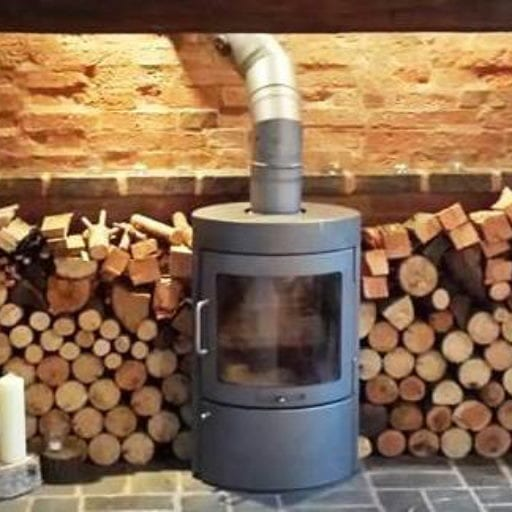 Modern-stylish-grey-log-burner-installation-with-logs-in-background