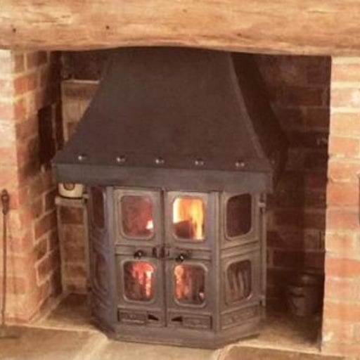 traditional-log-burner-installation-set-in-a-brick-feature-fireplace